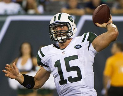New York Jets quarterback Tim Tebow passes against the Carolina Panthers in the fourth quarter of their pre-season NFL football game in East