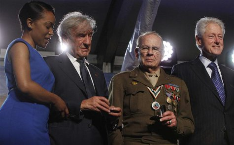 (L-R) Rebecca Dupas, U.S. Holocaust Museum founding chairman Elie Wiesel, 90-year-old WWII veteran Scottie Ooton and former U.S. President B