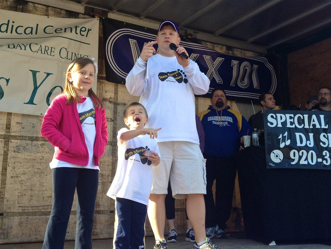 March of Dimes Advocate and one of the March's coordinator Andy Van Remortel and family address the crowd