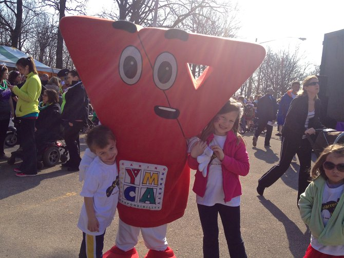 Stayin' healthy at the March with the YMCA Mascot!