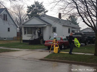 Local and state authorities investigate the homicide death of Patricia Waschbisch at 526 Thompson St. in Peshtigo, April 29, 2013. (courtesy of FOX 11).