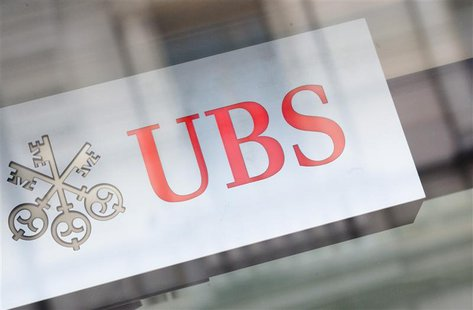 The logo of Swiss bank UBS is seen on a building in Zurich, February 13, 2013. REUTERS/Michael Buholzer (SWITZERLAND - Tags: BUSINESS LOGO)