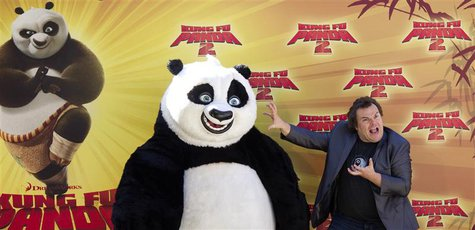 "U.S. actor Jack Black poses with ""Po"", his character in ""Kung Fu Panda 2"", during a photocall to promote the movie at Madrid's zoo, June 10,"
