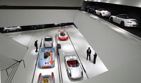 Visitors stroll through the museum of German sports car manufacturer Porsche in Stuttgart, January 9, 2013. REUTERS/Kai Pfaffenbach
