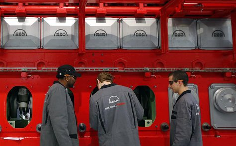 Workers assemble a large Diesel engine at the MAN Diesel & Turbo factory in Augsburg March 6, 2013. MAN Diesel & Turbo, a a company within t
