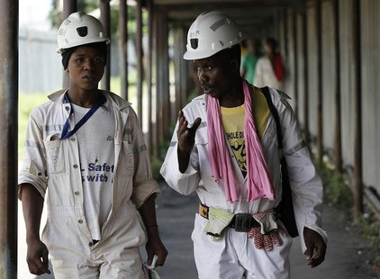 Miners walk at the end of their shift at the Anglo Platinum's Khuseleka shaft 1 mine in Rustenburg, northwest of Johannesburg, January 15, 2