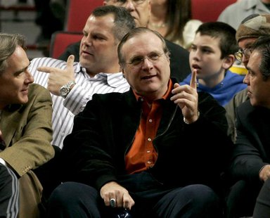 Portland Trail Blazers owner and billionaire Paul Allen (C) talks to the team president Steve Patterson (L) in front of fans during the team