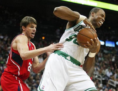 Boston Celtics center Jason Collins (R), grabs a rebound away from Atlanta Hawks guard Kyle Korver in the first half of their NBA basketball