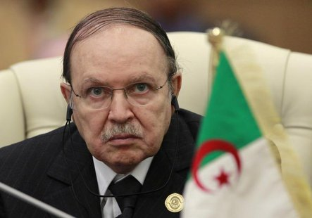 Algeria's President Abdelaziz Bouteflika listens to the speech of Libya's leader Muammar Gaddafi at the start of the third European Union-Af