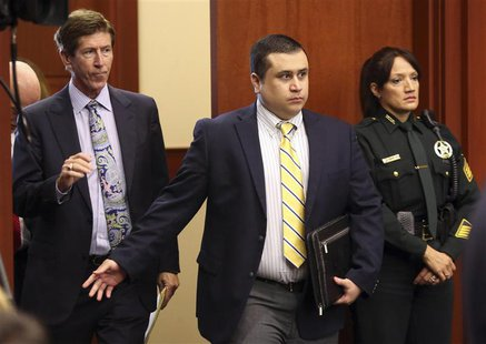George Zimmerman, defendant in the killing of Trayvon Martin, arrives in Seminole circuit court in Sanford, Florida, with his attorney Mark