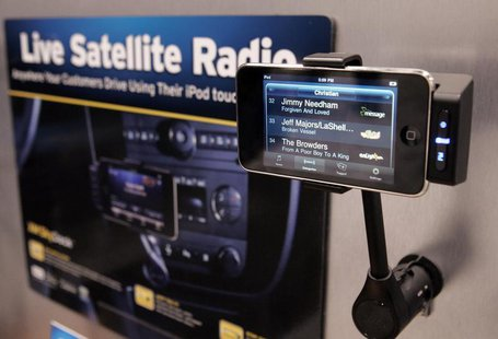 An Apple iPhone is shown in a XM Skydock at the Sirius Satellite Radio booth during the 2010 International Consumer Electronics Show (CES) i