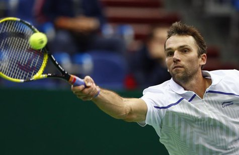Croatia's Ivo Karlovic hits a return against Brazil's Thomaz Bellucci during their Kremlin Cup semifinal tennis match in Moscow October 20,