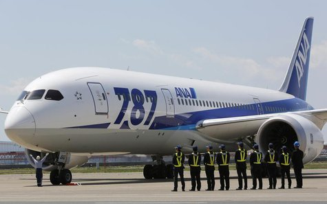 Employees of All Nippon Airways (ANA) queue in front of the company's Boeing 787 Dreamliner plane after its test flight at Haneda airport in