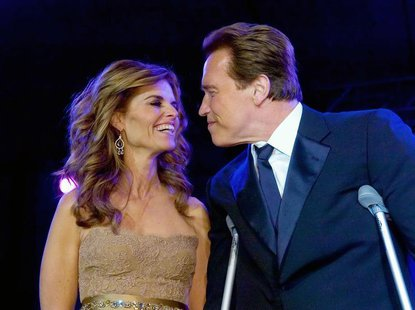 California Governor Arnold Schwarzenegger (R) smiles with his wife Maria Shriver at the Governor's Inaugural Ball at the Sacramento Conventi