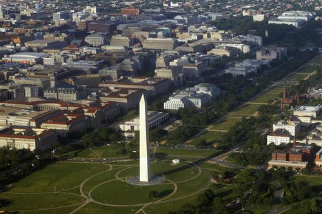 The Washington Monument and surrounding office buildings are seen in an aerial view in this file photo taken May 19, 2011. REUTERS/Jim Bourg