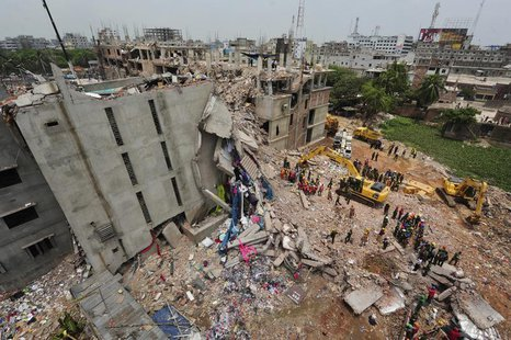 A view of rescue workers attempting to find survivors from the rubble of the collapsed Rana Plaza building in Savar, around 30 km (19 miles)