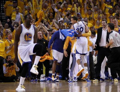 Golden State Warriors Stephen Curry (R) and Draymond Green celebrate against the Denver Nuggets during Game 4 of their NBA Western Division