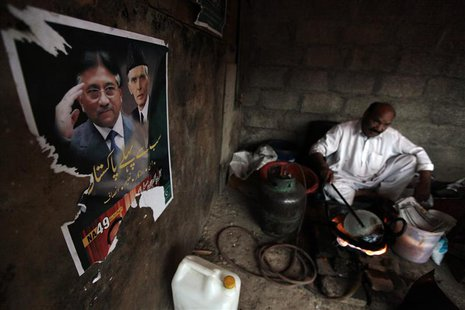 A poster of former President and head of the All Pakistan Muslim League (APML) political party Pervez Musharraf (L), with Muhammad Ali Jinna
