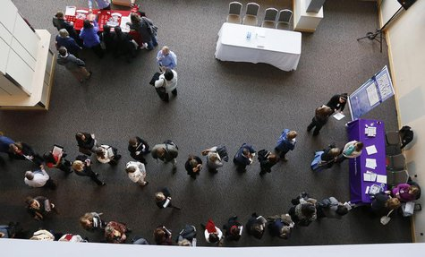 Hundreds of job seekers wait in line with their resumes to talk to recruiters (right) at the Colorado Hospital Association health care caree