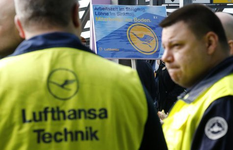 Union members attend a rally as they take part in a warning strike of German air carrier Lufthansa's ground personnel at Tegel airport in Be