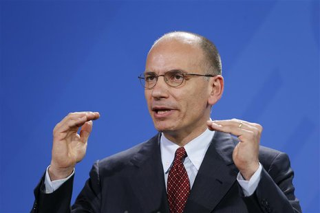 Italian Prime Minister Enrico Letta gestures as he addresses a joint news conference with German Chancellor Angela Merkel (not pictured) at