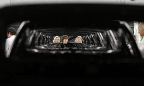 Associate are seen inspecting a 2013 Accord during a tour of the Honda automobile plant in Marysville, Ohio October 11, 2012. REUTERS/Paul V