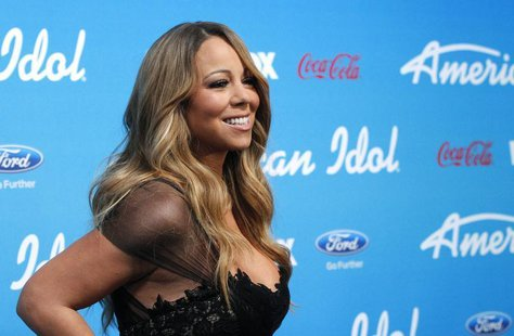 "Judge Mariah Carey poses at the party for the finalists of the television show ""American Idol"" in Los Angeles, California March 7, 2013. REU"