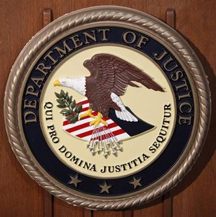 The Department of Justice logo is seen on the podium during a news conference on the Gozi Virus in New York January 23, 2013. REUTERS/Carlo