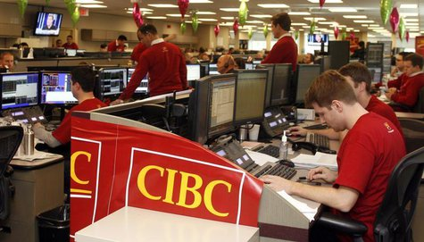 Traders are shown working at the Canadian Imperial Bank of Commerce (CIBC) trading floor during 'Miracle Day' in Toronto December 2, 2009. R