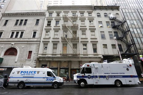 A New York Police Department truck and a City of New York Medical Examiner mobile lab park in front of 51 Park Place in New York, April 29,