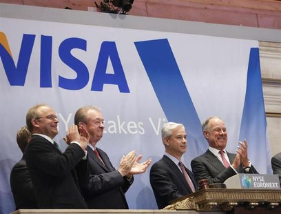 Visa CEO Charles Scharf (2nd R) and company executives ring the opening bell at the New York Stock Exchange, March 19, 2013. REUTERS/Brendan