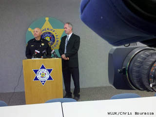 Winnebago Co. Sheriff John Matz, left, and District Attorney Christian Gossett hold a news conference May 1, 2013, to discuss the April 19 fatal shooting of a man by a town of Menasha police officer. (courtesy of FOX 11).