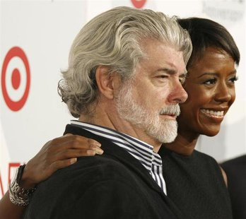 Director George Lucas and girlfriend Mellody Hobson, president of Ariel Capital Management, arrive at the American Film Institute's 40th ann
