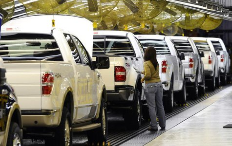 An employee works on the new 2009 Ford F-150 on the assembly line at Ford's Kansas City Assembly Plant in Claycomo, Missouri October 2, 2008