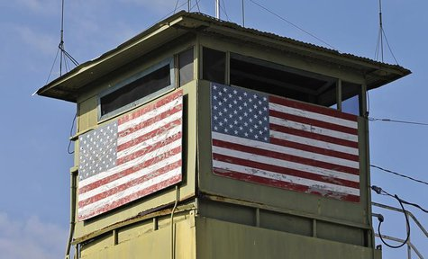 A U.S. Marine guard tower overlooks the Northeast gate leading into Cuba territory at Guantanamo Bay U.S. Naval Base, March 8, 2013. Picture