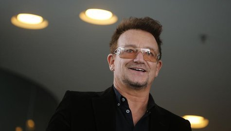 Bono, lead singer of the band U2 and ONE organisation co-founder arrives for a reception with German Chancellor Angela Merkel and with youth