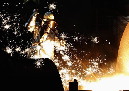 A worker controls a tapping of a blast furnace at Europe's largest steel factory of Germany's industrial conglomerate ThyssenKrupp AG in the