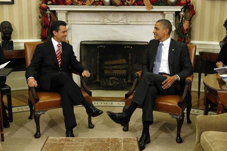U.S. President Barack Obama meets with President Enrique Pena Nieto of Mexico in the Oval Office of the White House in Washington November 2