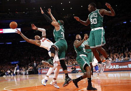 New York Knicks' J.R. Smith (L) tries to pass as he is defended by Boston Celtics' Paul Pierce(2nd from L) in the fourth quarter in Game 5 o