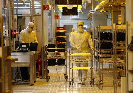 Employees are pictured inside a clean room of German semiconductor manufacturer Infineon in Regensburg February 12, 2013. REUTERS/Michael Da