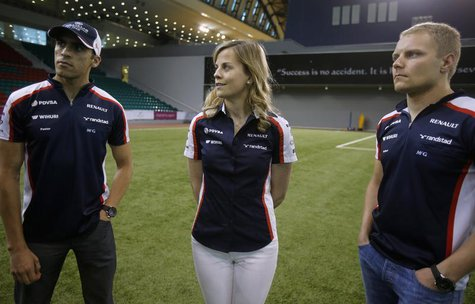 Williams Formula One drivers Pastor Maldonado (L) of Venezuela, Valtteri Bottas (R) of Finland and test-driver Susie Wolff of Britain visit