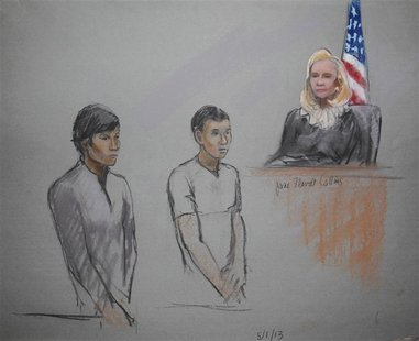 Defendants Dias Kadyrbayev (L) and Azamat Tazhayakov are pictured in a courtroom sketch, appearing in front of Federal Magistrate Marianne B
