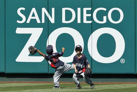 Unidentified children of National League All-Stars play in the outfield during practice for Major League Baseball's All-Star Game in Anaheim