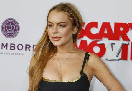 "Actress Lindsay Lohan arrives at the premiere of the film ""Scary Movie 5"" in Hollywood April 11, 2013. REUTERS/Fred Prouser"