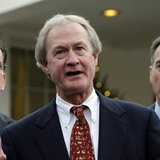 Newly elected Rhode Island Governor Lincoln Chafee (C) speaks to the media between other Governors-elect Dan Malloy of Connecticut (L) and P