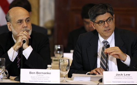 U.S. Treasury Secretary Jack Lew (R) and Chairman of the Federal Reserve Bank Ben Bernanke (L) attend the Treasury Department's Financial St