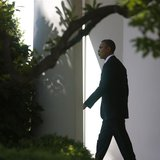 U.S. President Barack Obama whistles as he walks to Marine One at the White House in Washington, May 2, 2013. Obama flew to Mexico on Thursd