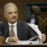 U.S. Attorney General Eric Holder refers to his notes during testimony before the Senate Judiciary Committee on Capitol Hill in Washington,