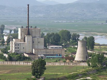 A North Korean nuclear plant is seen before demolishing a cooling tower (R) in Yongbyon, in this photo taken June 27, 2008 and released by K