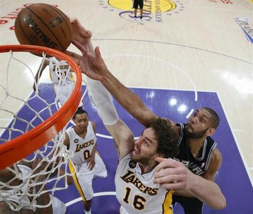 San Antonio Spurs Tim Duncan (back R) blocks a shot by Los Angeles Lakers Pau Gasol during Game 4 of their NBA Western Conference Quarterfin